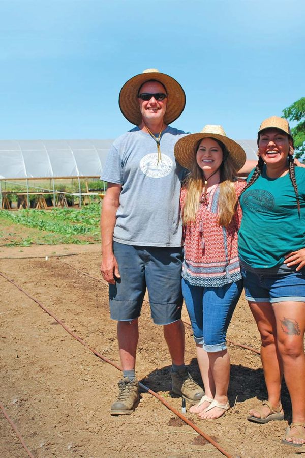 Jay Mominee, Carrie Lustig, and Krystal Dixon put in a full day seeding some summer crops.